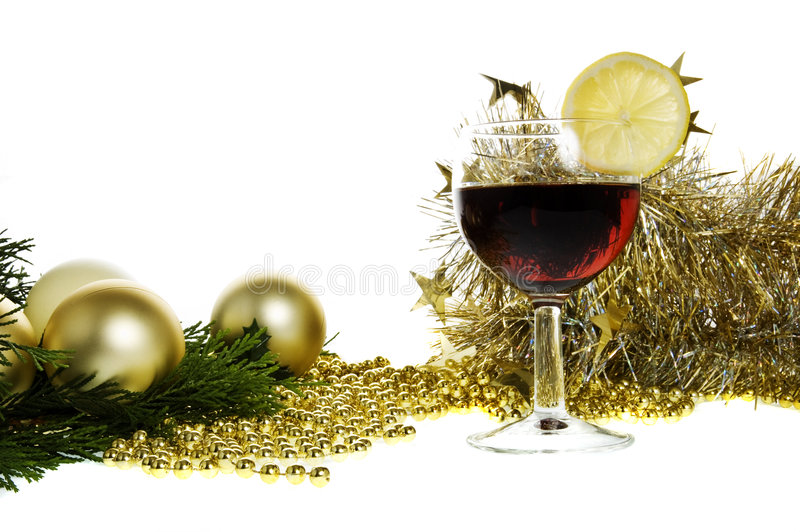 Gold christmas baubles & wine royalty free stock photo