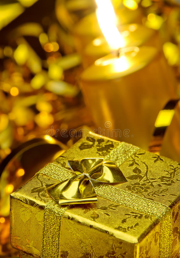 Gold Christmas Candles And Gold Gift Boxes Royalty Free Stock Image