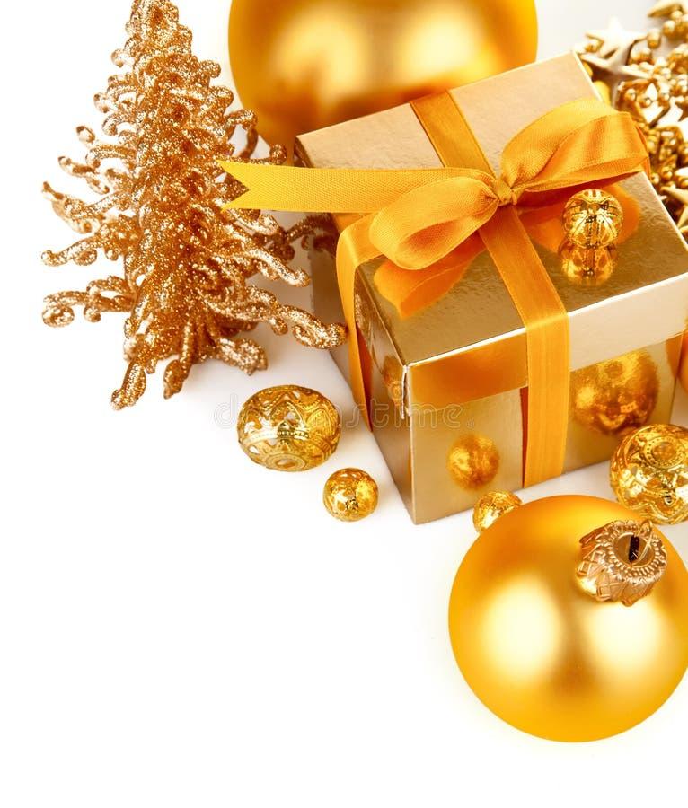 Gold Christmas Gift With Balls Stock Photos