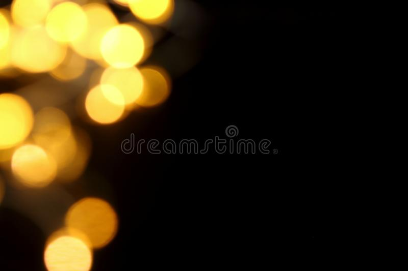 Gold Christmas lights soft focus bokeh background with copy space stock photos