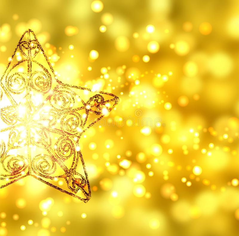 Gold Christmas star on gold background with sparks stock photo