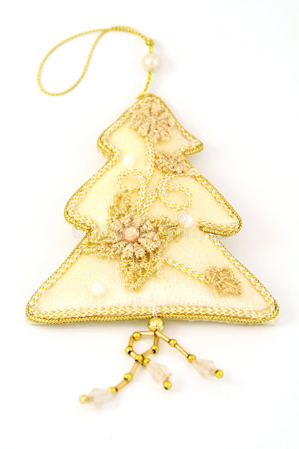 Gold christmas tree. Decorated with pearls and embroidery royalty free stock images