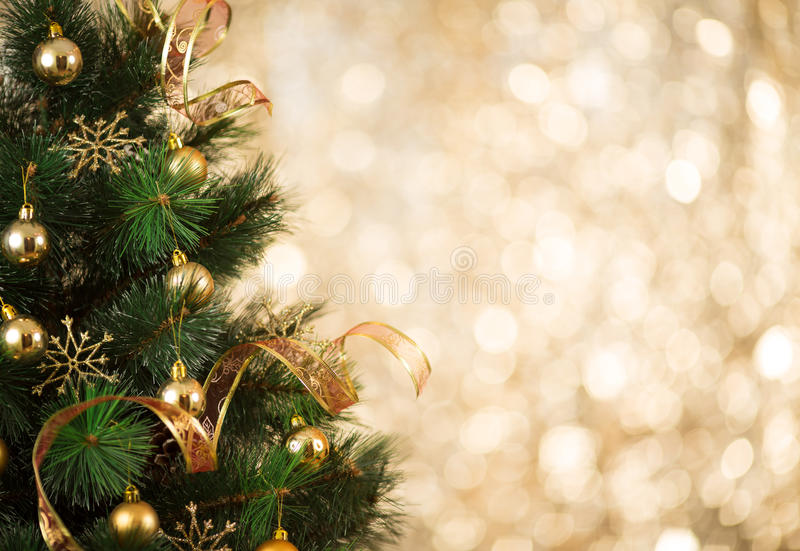 Gold Christmas tree background of defocused lights. Gold Christmas background of defocused lights with decorated tree