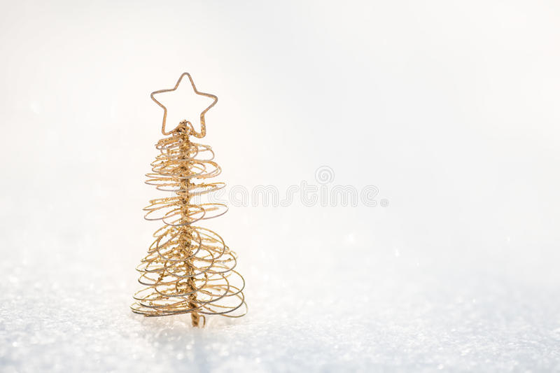 Gold Christmas tree decoration on snow