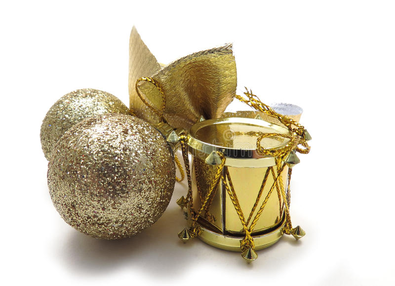Gold Christmas tree ornaments. Drum, ribbon and sparkly balls stock photos