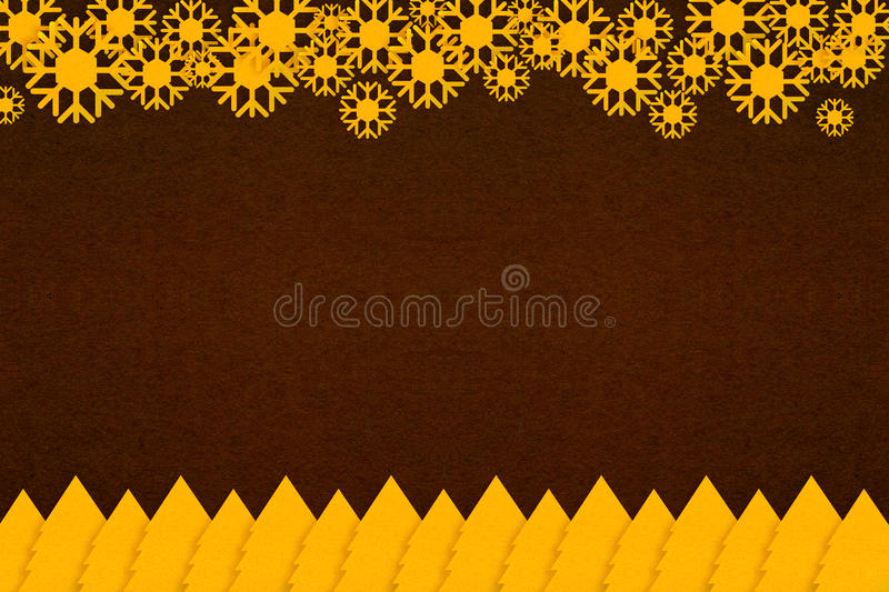 Gold christmas tree paper and abstract snowflake on dark brown paper texture royalty free stock images