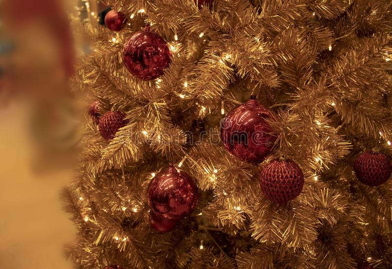 Gold Christmas Tree with red shiny ornament stock photos