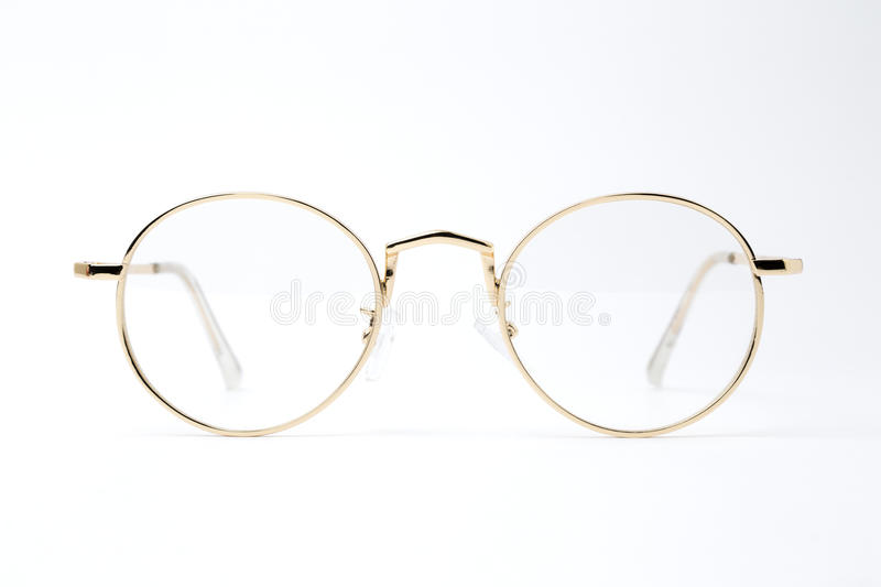 Gold classic round glasses on white background royalty free stock image