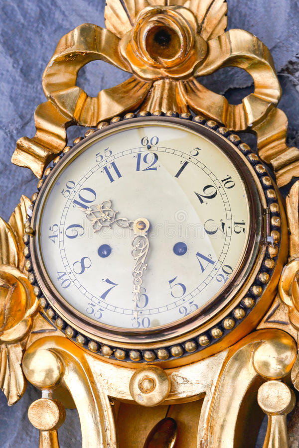 Gold Clock. Vintage Round Analog Gold Clock for Wall royalty free stock photography