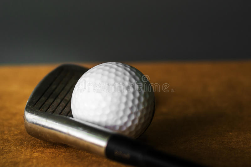 Gold Club and Ball stiil life stock photography
