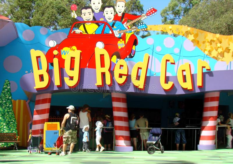 Unidentified group of people at Big Red Car entrance buying tickets at the tickets counter in Dreamworld, Gold Coast, Australia. Gold Coast, Australia - April royalty free stock photo
