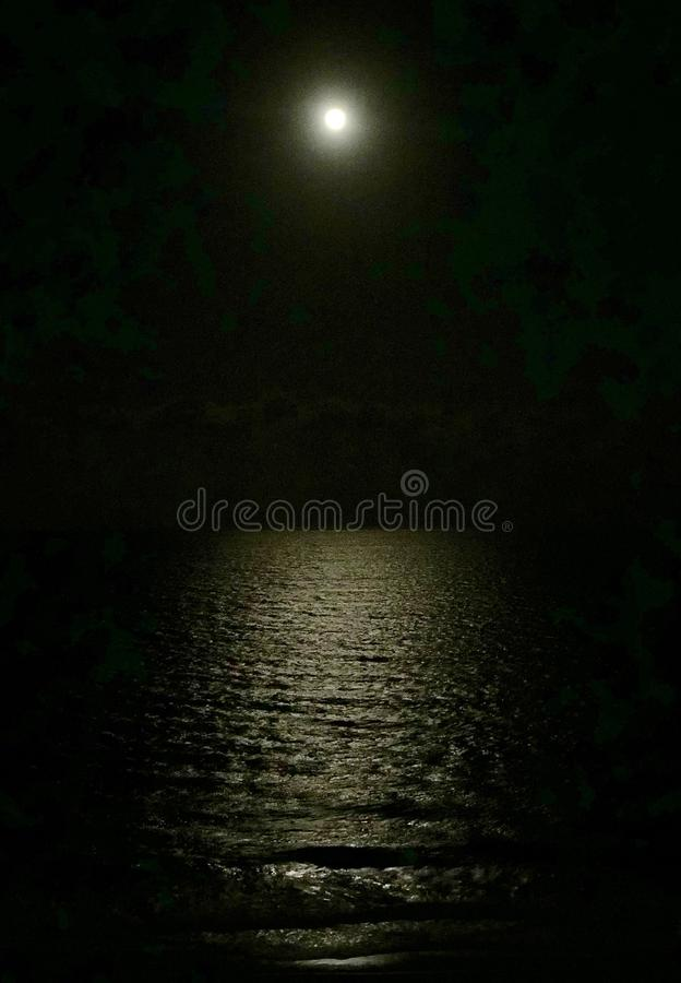 Full moon over the ocean. iPhone photography stock photos