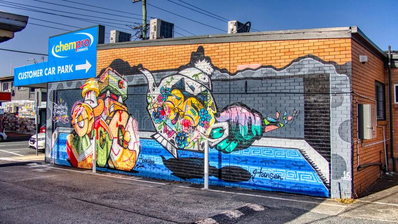 Gold Coast Queensland Australia October 20 2018 mural graffiti wall art of colourful tea pot, cat, donuts in parking lot royalty free stock photos