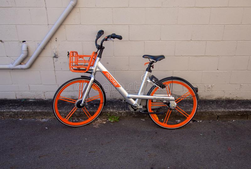 Gold Coast Queensland Australia September 25 2018 Mobike next to a wall. Gold Coast Queensland Australia September 25 2018 Mobike parked next to a wall stock photo