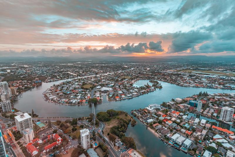 Gold Coast residential area at sunset. Gold Coast residential area and Nerang River at sunset stock photo