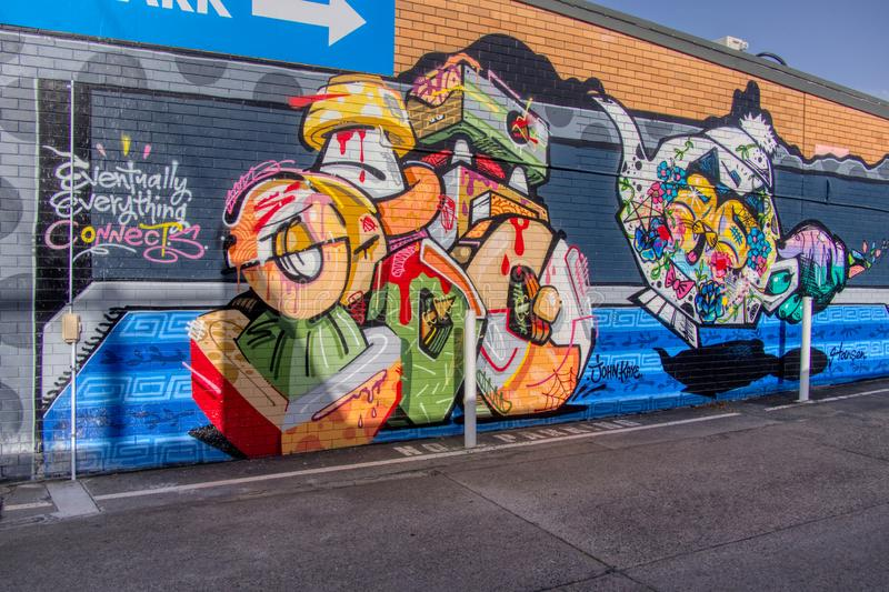 Gold Coat Queensland Australia October 20 2018 mural graffiti wall art of colourful tea pots and cat in parking lot royalty free stock photo