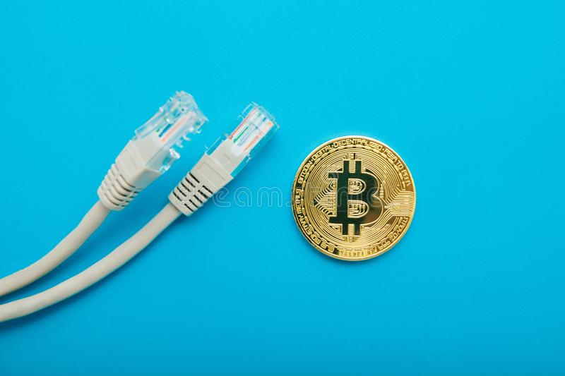 Gold coin bitcoin with internet wires on a blue background stock images