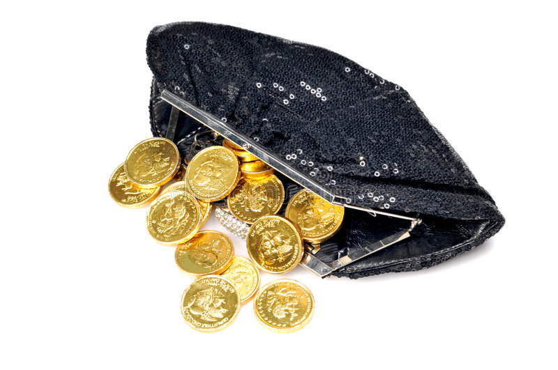 Gold coins. Coming out of ladies purse royalty free stock photos