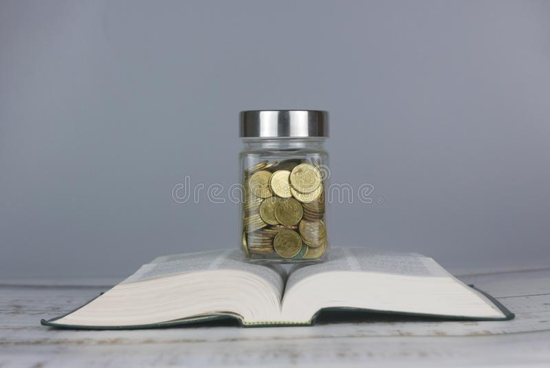 Gold coins on book. Finance and education concept. Money, university, college, school, student, investment, study, savings, bank, financial, background stock images