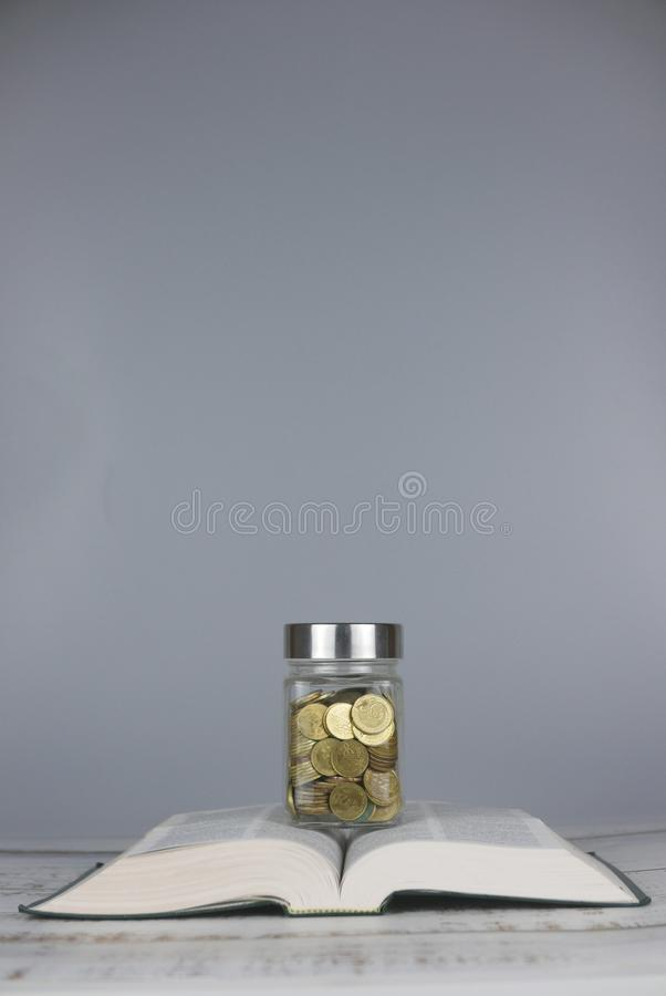 Gold coins on book. Finance and education concept. Copy space for text or logo royalty free stock photos