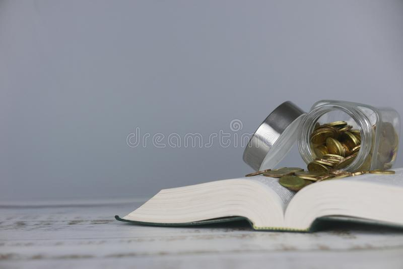 Gold coins on book. Finance and education concept. copy space for text or logo. Money, university, college, school, student, investment, study, savings, bank stock photo