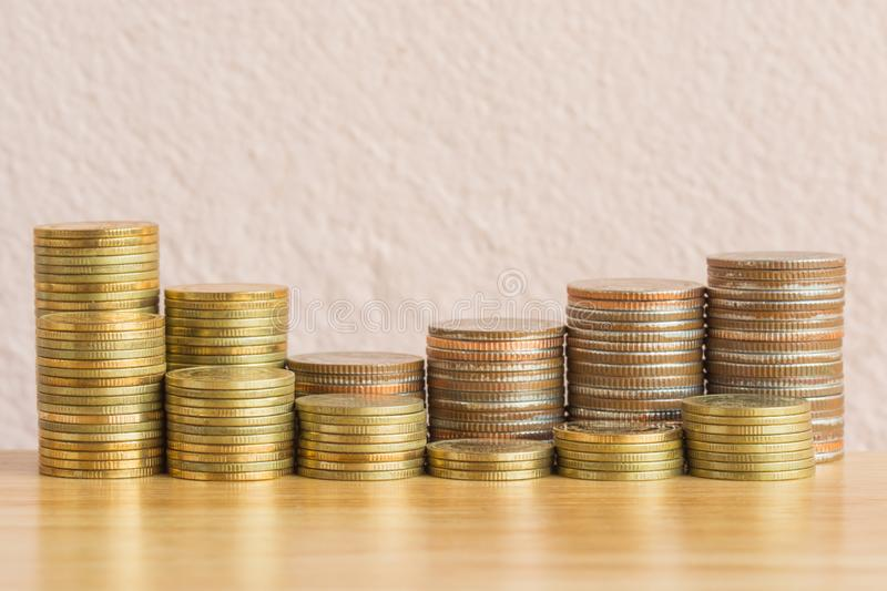 Gold coins and Bronze coins on wooden table royalty free stock photography