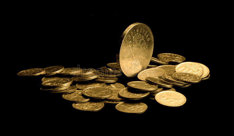 Gold coins close-up royalty free stock photos