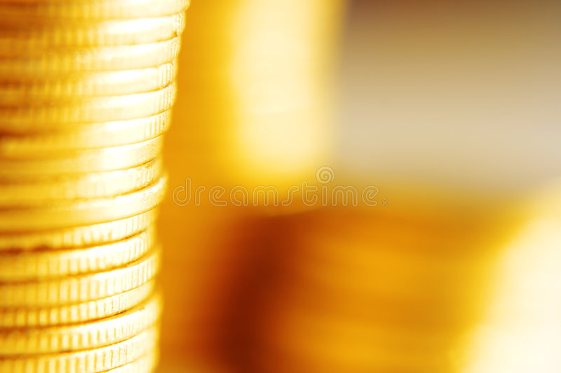 Gold coins close-up stock images