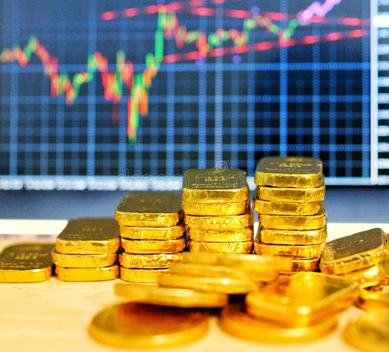 Free Gold Coins, Gold Bars, Sorting, Concept, Saving, Education, Gold Investment  Forex Trading, Stock Table Background Blur Royalty Free Stock Photography - 147600057