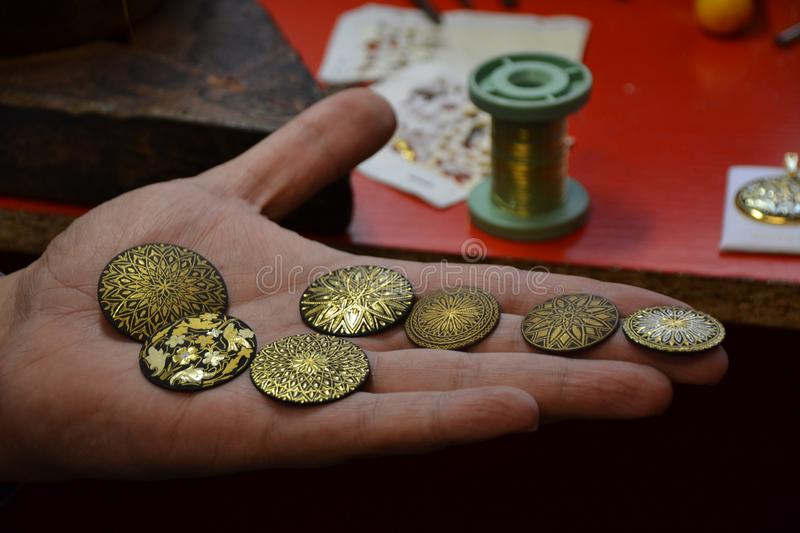 Gold coins in hand stock image