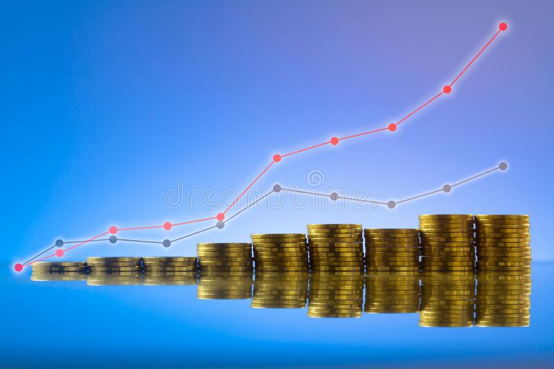 Gold coins stack with graph royalty free stock images