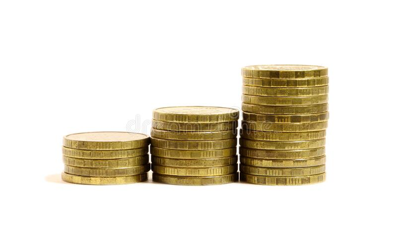 Gold coins stacks isolated on white background.  stock image