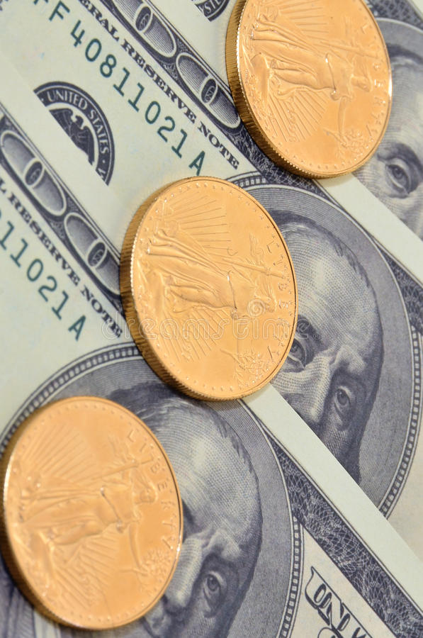 Download Gold Coins and US Currency stock photo. Image of negotiable - 24247188