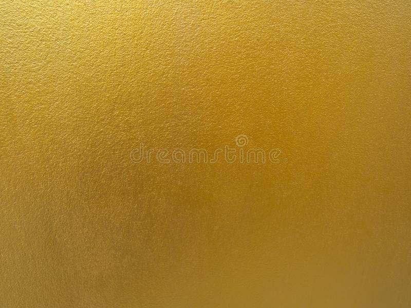Gold color background. Rough gold texture design on the wall royalty free stock photography