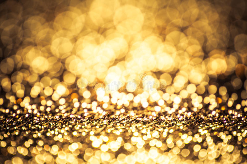 Gold color bokeh glitter background royalty free stock photography