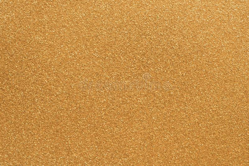 Gold grainy paper background texture. Gold color grainy paper background texture royalty free stock images