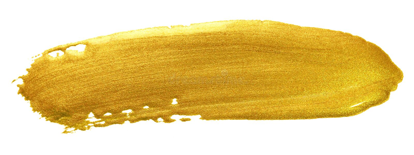 Gold color paint brush stroke. Acrylic golden smear stain on white background. Abstract detailed gold glittering textured wet pain royalty free stock photo