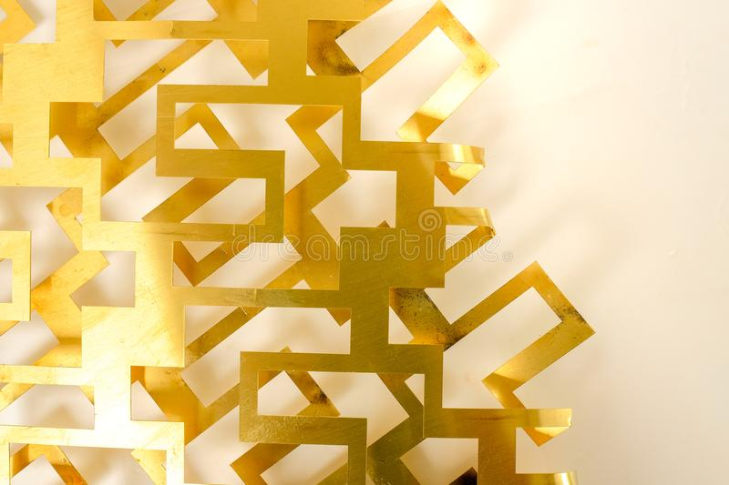 Brass sheet cut geometry on white background stock images