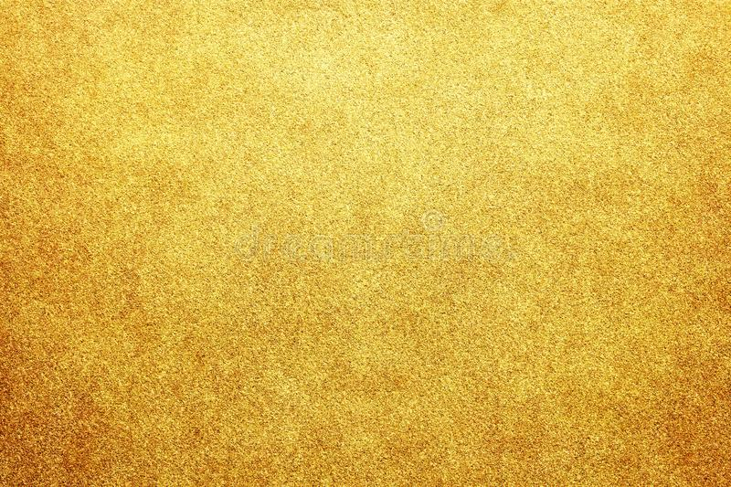 Gold colored glitter paper abstract or vintage texture background royalty free stock image
