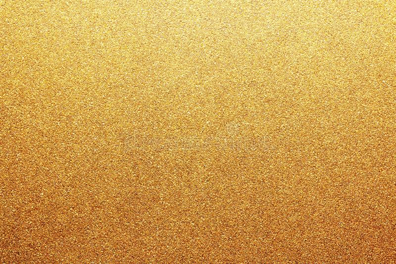 Gold colored glitter paper texture or vintage background stock images
