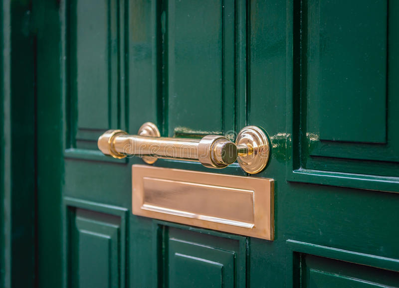 Download Gold Colored Handle And Mailbox In A Green Front Door From Close  Stock Image
