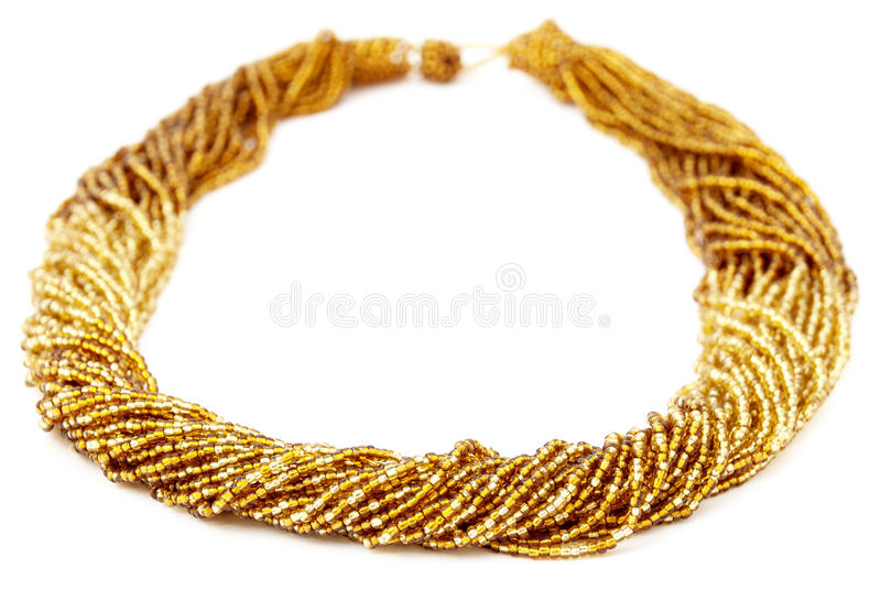 Gold Colored Multistrand Twisted Beaded Neckwear, Traditionally African royalty free stock image