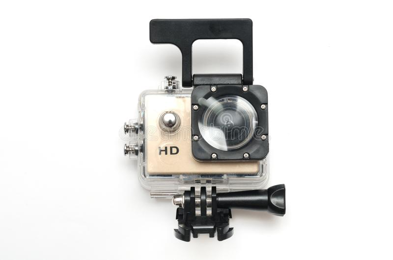 A gold colored small high definition HD action camera in a water proof kit case. A photo taken on a gold colored small high definition HD action camera in a royalty free stock photo