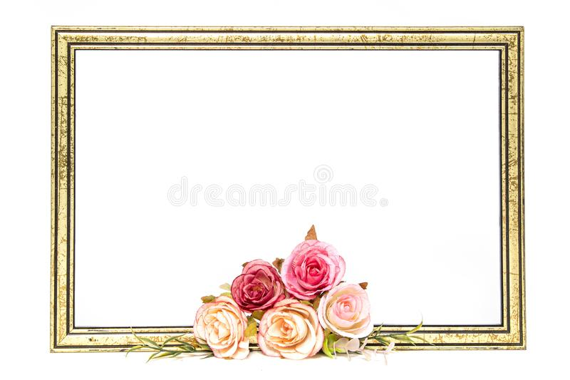 Gold colored wooden frame with roses stock photos