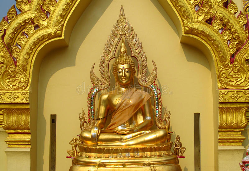 Gold colour Buddha statue in Buddhist temple. Statue of seated Buddhas coloured like gold. Buddha statue in a Buddhist temple. Sacred relic of Buddhism stock photography