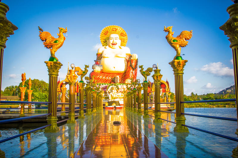 Gold columns leading to the statue on Samui stock images