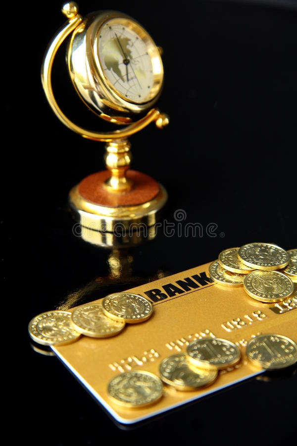Gold Credit Card. And watch on a black background stock photos