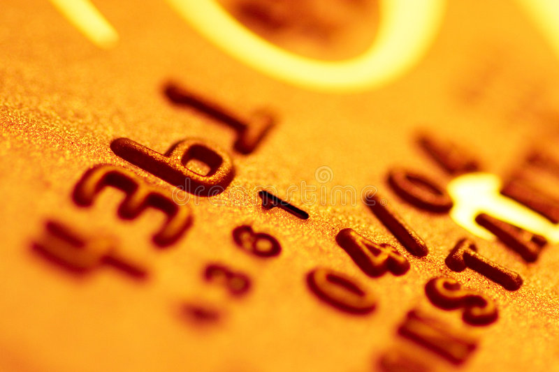 Gold credit card. Golden credit card background closeup stock photo
