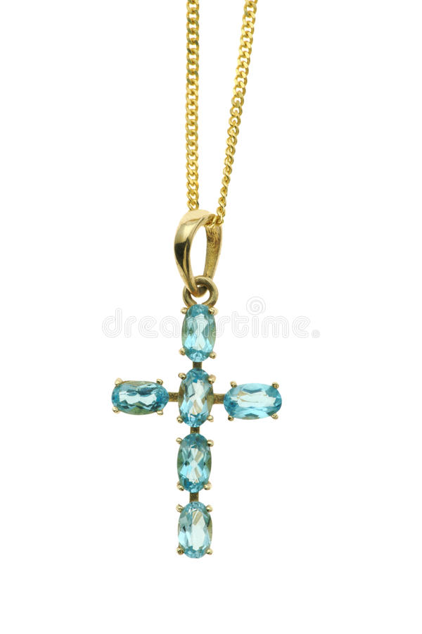 Gold Cross with blue gemstones stock photos
