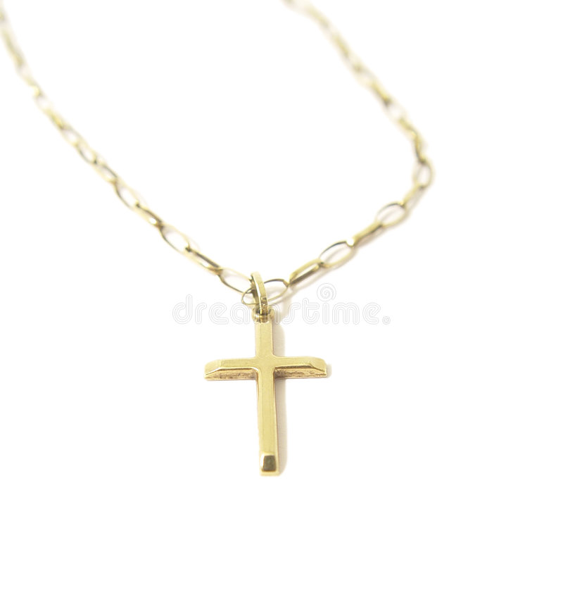 Gold cross on a chain royalty free stock photography